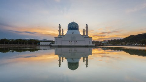 Time lapse of sunrise and scattered clouds and sun rays at Kinabalu city Mosque in Likas, Kota Kinabalu, Sabah, Malaysia. Prores 1080p. Pan up motion timelapse.