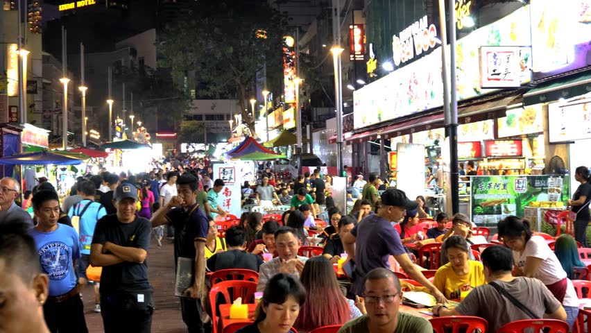 KUALA LUMPUR, MALAYSIA, December 29, 2018: Tourist visiting Jalan Alor, popular attraction for cuisine street food in Kuala Lumpur, Malaysia | Shutterstock HD Video #1021625464