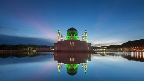 Time lapse of sunrise and scattered clouds and sun rays at Kinabalu City Mosque in Likas, Kota Kinabalu, Sabah, Malaysia. Prores 1080p.