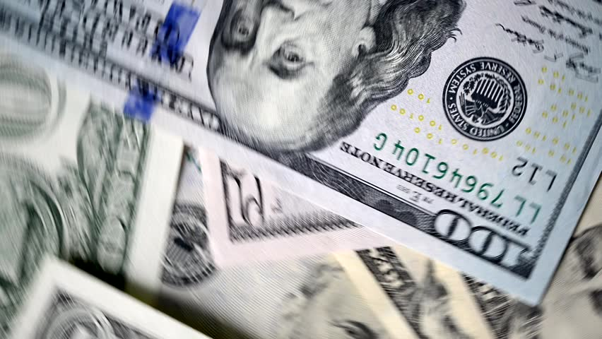 Extremely close-up of US dollars banknotes, rotational motion     Shutterstock HD Video #1021645324