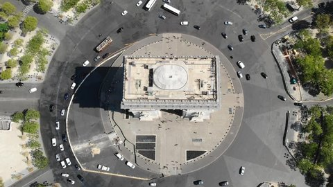 Arc de Triomphe on square Place Charles de Gaulle with traffic at sunny day. Aerial view. Top view
