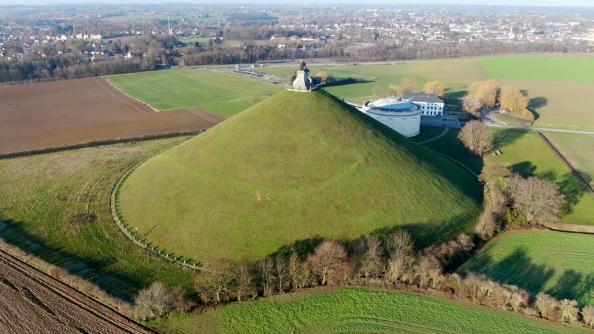 Aerial view of The Lion's Mound with farm land around.  The immense Butte Du Lion on the battlefield of Waterloo where Napoleon died. Belgium.  | Shutterstock HD Video #1021834564