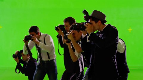 Group of paparazzi or journalists on green screen . Group of photographers photo shooting on green screen. Slow motion. Shot on RED EPIC Cinema Camera.