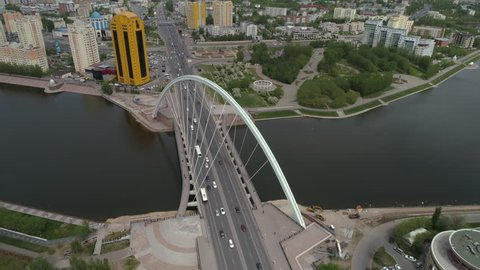 Astana, Kazakhstan - May 29, 2018: The day view of passing cars on a bridge in old city centre