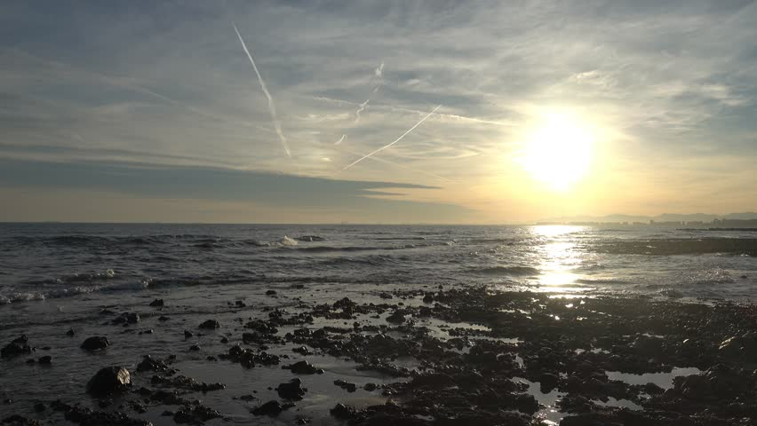 Sunset on the coast of the renega of Oropesa del Mar | Shutterstock HD Video #1022014714