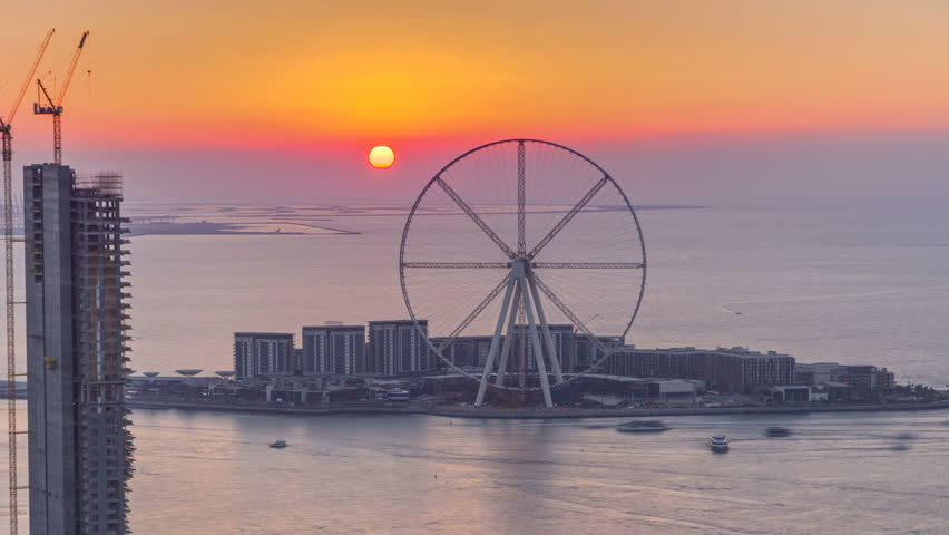Bluewaters island at sunset aerial timelapse with ferris wheel, new walking area with shopping mall and restaurants, newly opened leisure and travel spot in Dubai | Shutterstock HD Video #1022019964