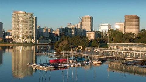 Aerial Shot Of Oakland City Skyline, boat club and Lake Merritt At Sunrise