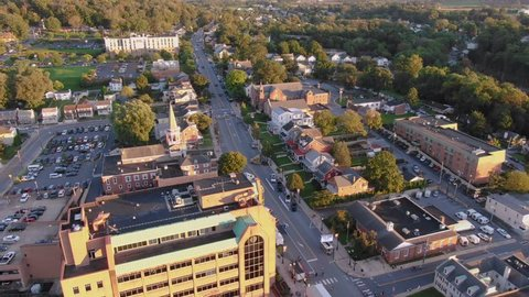 Drone descending over a church in small town America during Golden Hour