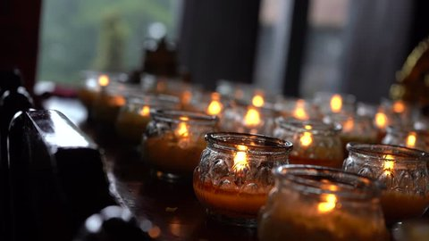 Burning candles in Buddhist temple