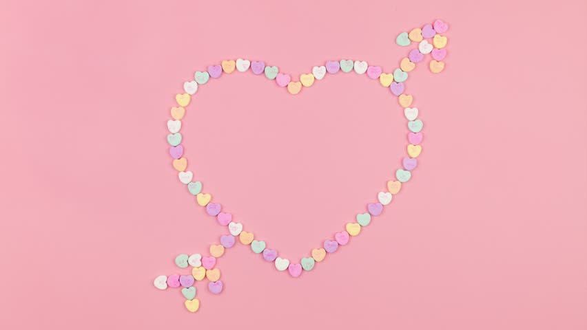 Conversation Candy Heart with Arrow Stop Motion Animation on Pink Background - Valentine's Day