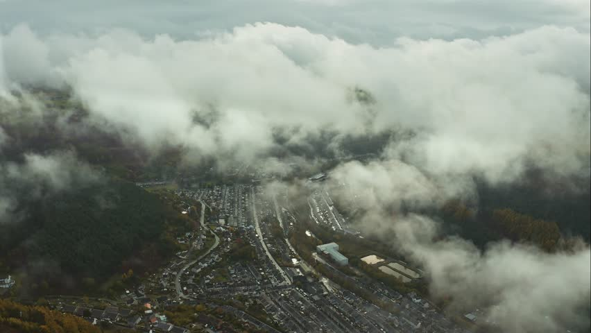 Aerial view of small town in south wales while soaring through the clouds ( South Wales Abertillery ) | Shutterstock HD Video #1022260774
