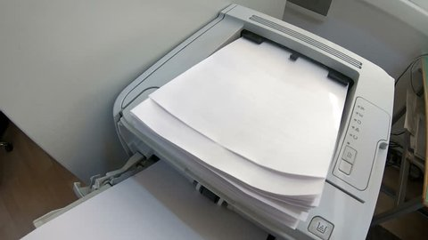 Laser Print machine printing documents in office