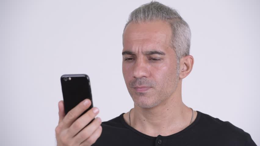 Happy handsome Persian man using phone | Shutterstock HD Video #1022395354