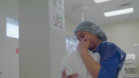 Santo Domingo, Dominican Republic; Dec 21 2017. Mother loads her newborn baby in a hospital. 4K footage.