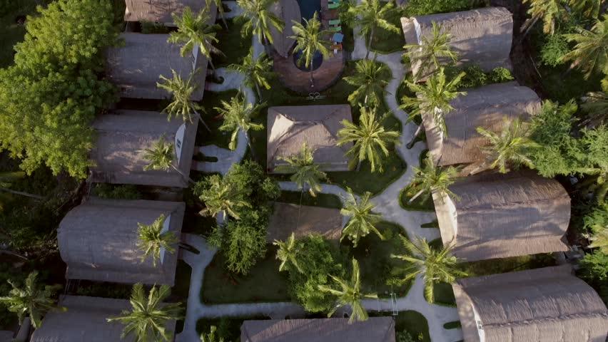 Aerial view of bungalows in a luxury resort, Gili Trawangan island, Indonesia. | Shutterstock HD Video #1022478154