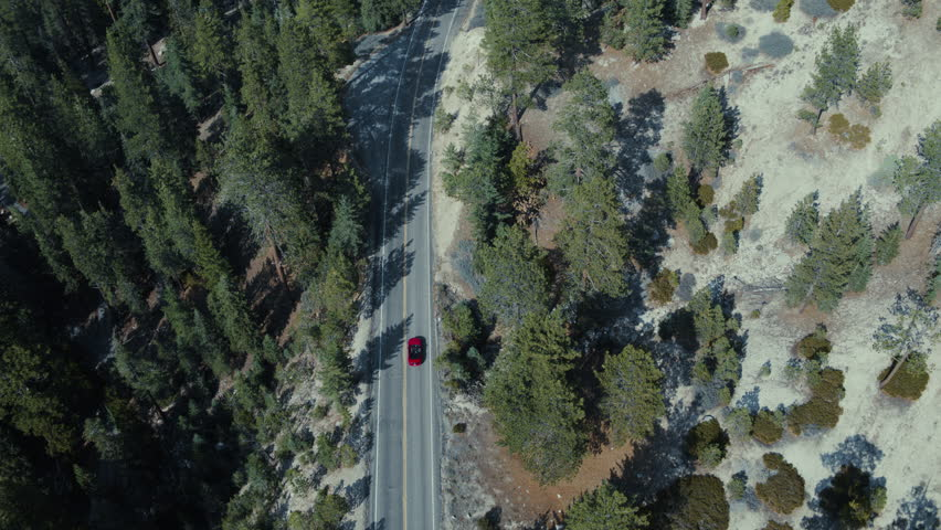 Car Driving Through the Woods, Big Bear Mountain, California - 08/04/2017 Aerial Shot on Inspire 2 Zenmuse X7 ProRes HQ.mov | Shutterstock HD Video #1022480914