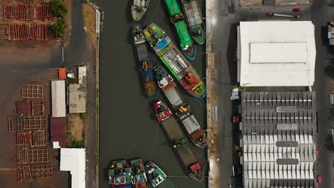 aerial view cargo and passenger seaport with ships and crane Tanjung Perak, surabaya, indonesia. docks for the repair and parking of ships, cargo port and container terminal. ship in industrial port
