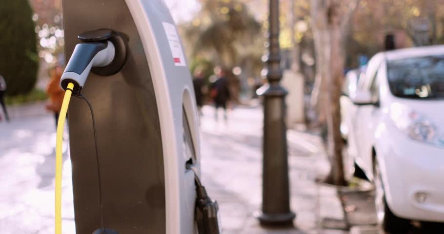 Electric car charging in street | Shutterstock HD Video #1022538784