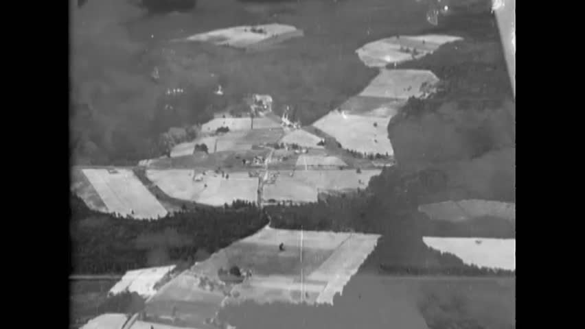 CIRCA 1943 - Aerial footage shot from an SB2C Helldiver shows coastal areas. | Shutterstock HD Video #1022572744
