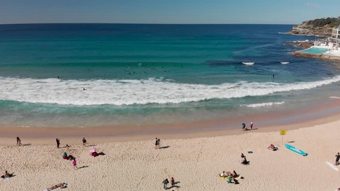 Aerial view of Bondi Beach coastline with surfers, Sydney, Australia.