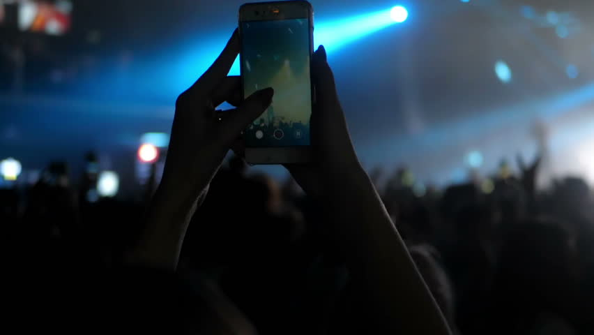 Girl and boy at a concert seating on shoulders dance   Shutterstock HD Video #1022626534