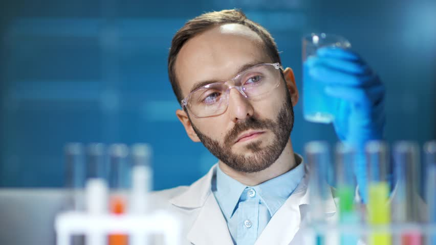 Microbiology male scientist conducting innovation experiment at futuristic digital lab background