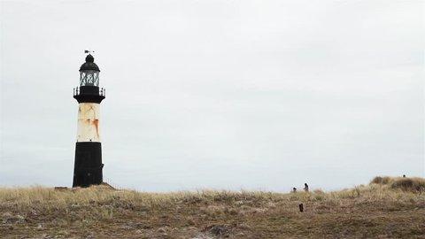 People Arriving at Pembroke Lighthouse, Falkland Islands.