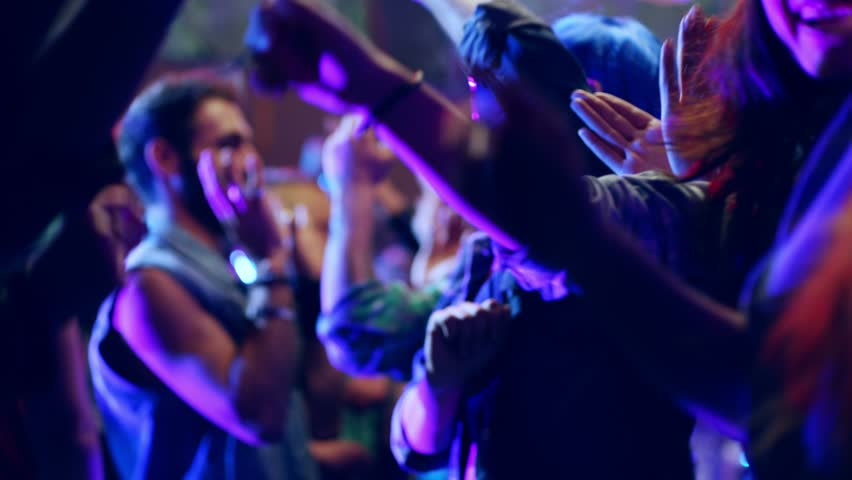 Footage of a crowd or group of young, stylish multi-ethnic people during colorful party in different clothes . Dancers having fun dancing at a party . Shot on RED HELIUM Cinema Camera in slow motion . | Shutterstock HD Video #1022655544