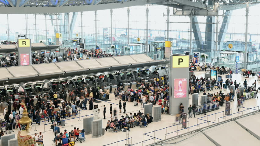 Bangkok, Thailand - January 8, 2019 : Time lapse of unidentified passengers at check in counter hall in Suvarnabhumi Airport
