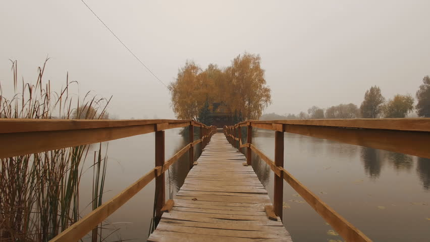 Fairytale house in the middle of the lake on an autumn foggy morning aerial | Shutterstock HD Video #1022690134