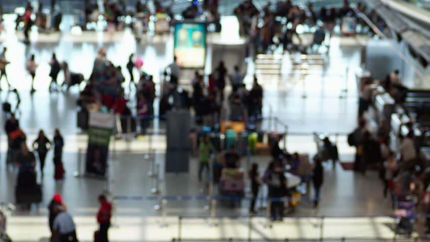 Blurred of tourist passengers walking at international airport. | Shutterstock HD Video #1022696464