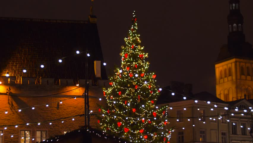 Holidays and celebration concept - christmas tree at old town hall square in evening tallinn | Shutterstock HD Video #1022750404