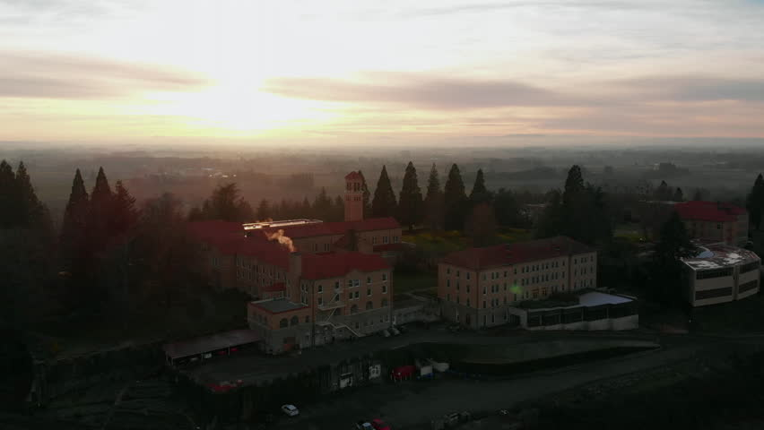 UHD 4K Aerial footage of Mount Angel Abbey Monastery Historical building during sunset in Oregon 3840x2160 Ultra High Definition | Shutterstock HD Video #1022778334
