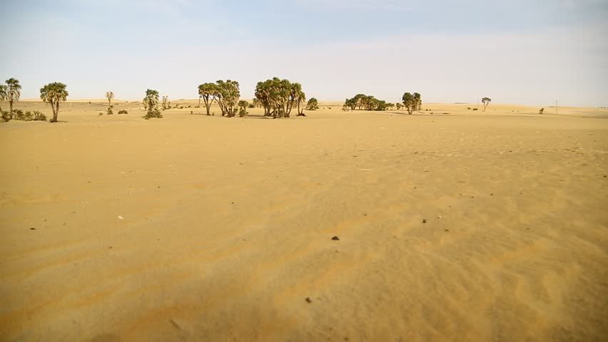 In the middle of the desert rock and track like concept of wild and nature scenic land   | Shutterstock HD Video #1022804854