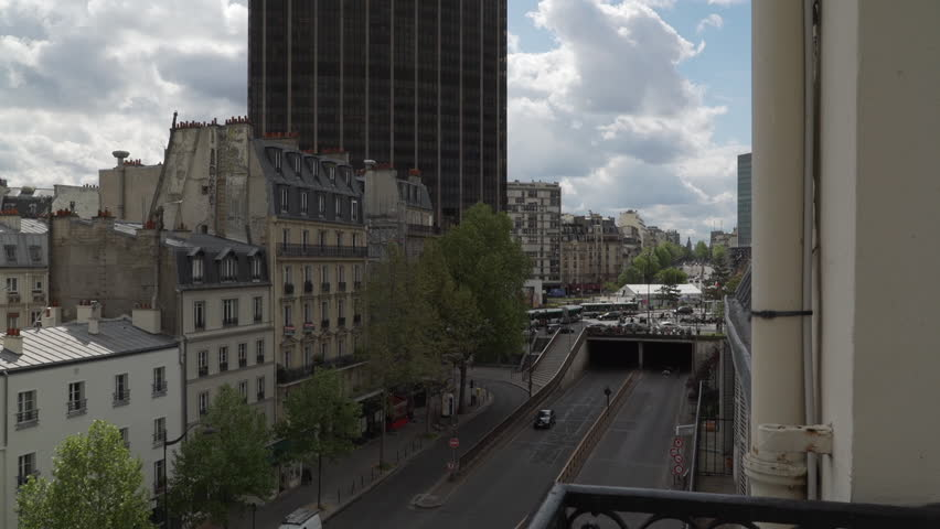 Circulation in the streets at the foot of the Montparnasse Tower, Paris, France | Shutterstock HD Video #1022819494