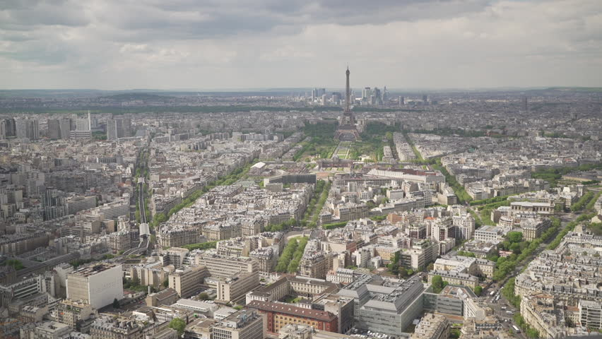 Large view of the city of Paris with the Eiffel Tower and the La Defense district behind, France | Shutterstock HD Video #1022819644