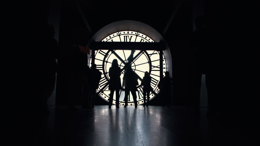 Silhouettes of people tourists near the big clock in the d'Orsay museum of Paris, France | Shutterstock HD Video #1022838964