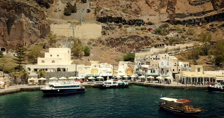 Aerial pull back from the Thira port revealing Santorini | Shutterstock HD Video #1022842414