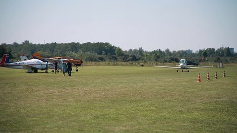 International flight festival of small aviation. Airfield of flying club. Small airplane aircraft is moving on the aerodrome