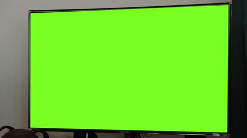 "LCD Television with Green Screen. Zoom In Shot. You can replace green screen with the footage or picture you want. You can do it with ""Keying"" (Chroma Key) effect (check out tutorials on YouTube)."