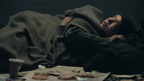 Crying emigrant lying on street, dreaming about home and family, losing hope