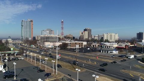 Tysons, VA / USA - December 27 2018: Aerial rise with tilt, wide shot showing entire Tysons Corner skyline from south across Leesburg Pike