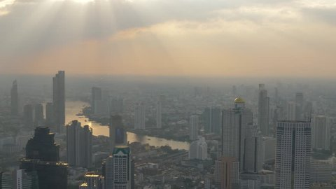 High view of Bangkok with Sun Light and Pollution along the Chao Phraya River. Thailand