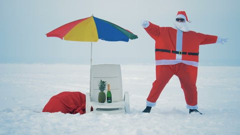 Man in Santa Claus costume dances on a snow, close up.
