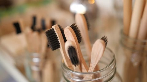 Young Mixed Race Woman Choosing Bamboo Eco Friendly Biodegradable Toothbrush in Zero Waste Shop. No plastic Conscious Minimalism Vegan Lifestyle. Reduce Reuse Recycle 4K Slowmotion Concept.
