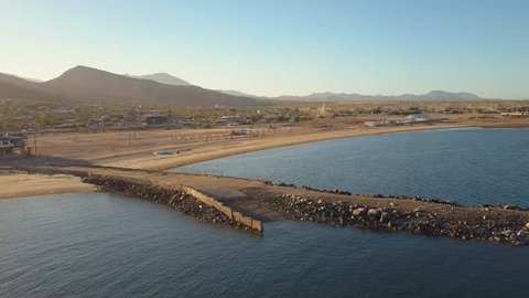 Aerial view of sunset over Bahia de los Angeles, Baja California, Mexico, over water towards beach.