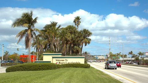FT. LAUDERDALE, FL - 2019: Welcome to Fort Lauderdale FL Signage with Vehicle Traffic Driving By Passing and Entering the South Florida City on a Sunny Tropical Day