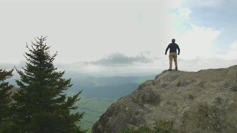 Mountain Summit hiker male victory
