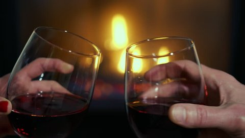 Slow Motion Romantic Wine Glass Cheers by Cozy Fireplace