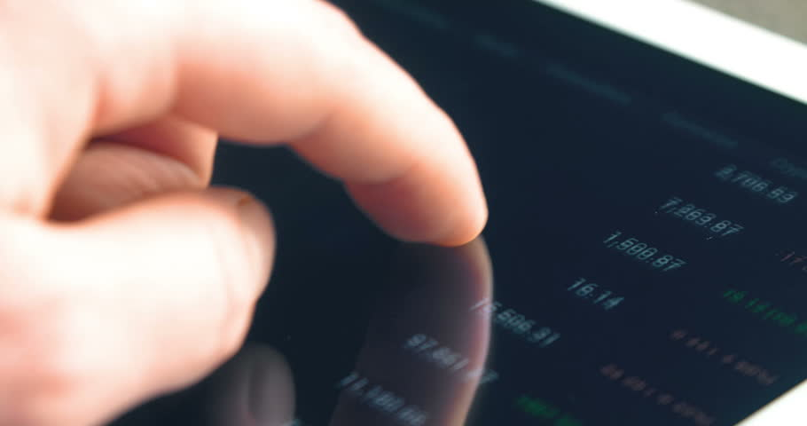 Trader working online with tablet on stock market. Close up 4k screen tablet with numbers and graphs. | Shutterstock HD Video #1023617164